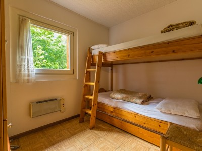 camera con letto a castello e letto estraibile